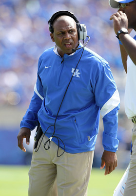 LEXINGTON, KY - SEPTEMBER 10:  Joker Phillips the head coach of the Kentucky Wildcats takes in the action during the game against the Central Michigan Chippewas at Commonwealth Stadium on September 10, 2011 in Lexington, Kentucky.  (Photo by Andy Lyons/Ge
