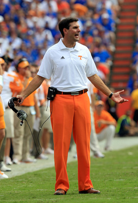 GAINESVILLE, FL - SEPTEMBER 17:  Head coach of the Tennessee Volunteers Derek Dooley speaks turnover his players during a game against the Florida Gators at Ben Hill Griffin Stadium on September 17, 2011 in Gainesville, Florida.  (Photo by Sam Greenwood/G