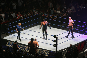 SYDNEY, AUSTRALIA - JUNE 15:  The Undertaker and ECW Champion Kane stand in the ring as the look down to Bam Neely, Chavo Guerrero, and The Great Khali during WWE Smackdown at Acer Arena on June 15, 2008 in Sydney, Australia.  (Photo by Gaye Gerard/Getty
