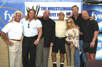 Ric Flair, Triple H, Bill Goldberg, Shawn Michaels, Trish Stratus, Kevin Nash and Stone Cold Steve Austin (Photo by Mychal Watts/WireImage)