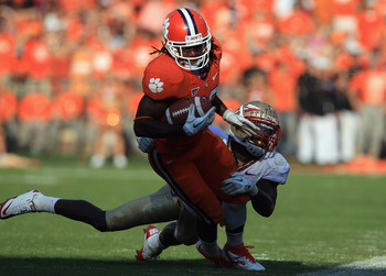 CLEMSON, SC - SEPTEMBER 24:  Andre Ellington #23 of the Clemson Tigers runs with the ball against Mike Harris #1 of the Florida State Seminoles during their game at Memorial Stadium on September 24, 2011 in Clemson, South Carolina.  (Photo by Streeter Lec