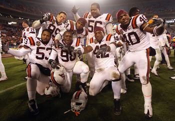 CHARLOTTE, NC - DECEMBER 04:  The Virginia Tech Hokies celebrate after defeating the Florida State Seminoles to win the ACC Championship 44-33 at Bank of America Stadium on December 4, 2010 in Charlotte, North Carolina.  (Photo by Streeter Lecka/Getty Ima
