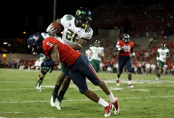 TUCSON, AZ - SEPTEMBER 24:  Runningback LaMichael James #21 of the Oregon Ducks is tackled by cornerback Shaquille Richardson #5 of the Arizona Wildcats during the college football game at Arizona Stadium on September 24, 2011 in Tucson, Arizona. The Duck