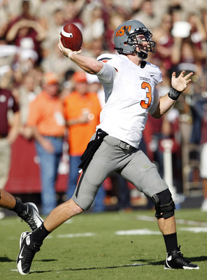 COLLEGE STATION, TX - SEPTEMBER 24:  Quarterback Brandon Weeden #3 of the Oklahoma State Cowboys throws to a receiver down-field against the Texas A&M Aggies at Kyle Field on September 24, 2011 in College Station, Texas. Oklahoma State won 30-29. (Photo b
