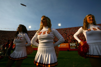 LOS ANGELES - SEPTEMBER 17:   The USC Trojans Song Girls perform in the game with the Syracuse Orangemen at the Los Angeles Memorial Coliseum on September 17, 2011 in Los Angeles, California. USC won 38-17.   (Photo by Stephen Dunn/Getty Images)