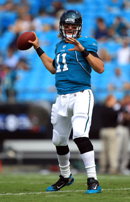 CHARLOTTE, NC - SEPTEMBER 25:  Blaine Gabbert #11 of the Jacksonville Jaguars drops back to pass during warm ups before their game against the Carolina Panthers at Bank of America Stadium on September 25, 2011 in Charlotte, North Carolina.  (Photo by Stre