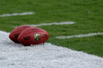 LANDOVER, MD - SEPTEMBER 01:  Footballs sit on the field before the start of a preseason game between the Washington Redskins and Tampa Bay Buccaneers at FedExField on September 1, 2011 in Landover, Maryland.  (Photo by Rob Carr/Getty Images)