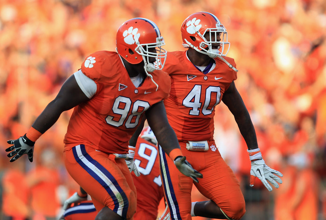 CLEMSON, SC - SEPTEMBER 24:  Teammates Kourtnei Brown #90 of the Clemson Tigers and Andre Branch #40 celebrate after a defensive stop during their game against the Florida State Seminoles at Memorial Stadium on September 24, 2011 in Clemson, South Carolin