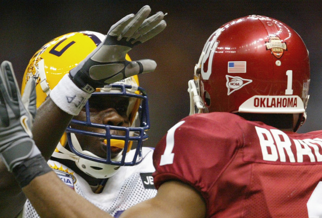 NEW ORLEANS - JANUARY 4:  Cornerback Travis Daniels  #29 of the Louisiana State University Tigers fights with defensive back Mark Bradley #1 of the University of Oklahoma Sooners during the National Championship Nokia Sugar Bowl game at the Louisiana Supe