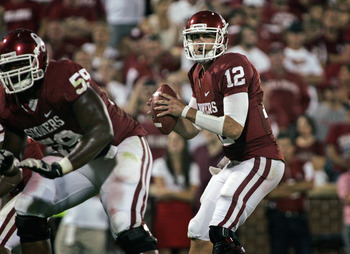 NORMAN, OK - SEPTEMBER 24:  Quarterback Landry Jones #12 of the Oklahoma Sooners looks to throw against the Missouri Tigers on September 24, 2011 at Gaylord Family-Oklahoma Memorial Stadium in Norman, Oklahoma.  Oklahoma defeated Missouri 34-14.  (Photo b