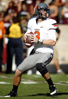 COLLEGE STATION, TX - SEPTEMBER 24:  Quarterback Brandon Weeden #3 of the Oklahoma State Cowboys looks for a receiver  against the Texas A&M Aggies at Kyle Field on September 24, 2011 in College Station, Texas. Oklahoma State won 30-29.  (Photo by Bob Lev