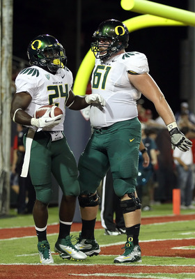 TUCSON, AZ - SEPTEMBER 24:  Runningback Kenjon Barner #24 of the Oregon Ducks celebrates with Nick Cody #61 after scoring on a 8 yard rushing touchdown against the Arizona Wildcats during the first quarter of the college football game at Arizona Stadium o