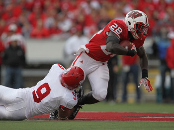 MADISON, WI - SEPTEMBER 24: Montee Ball #28 of the Wisconsin Badgers is tackled by Jim Thompson #9 of the South Dakota Coyotes at Camp Randall Stadium on September 24, 2011 in Madison Wisconsin. (Photo by Jonathan Daniel/Getty Images)