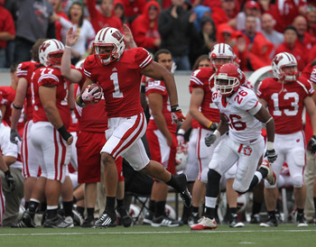 MADISON, WI - SEPTEMBER 24: Nick Toon #1 of the Wisconsin Badgers runs for a touchdown after a catch in front of Aaron Swift #26 of the South Dakota Coyotes at Camp Randall Stadium on September 24, 2011 in Madison Wisconsin. (Photo by Jonathan Daniel/Gett