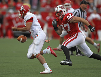 MADISON, WI - SEPTEMBER 24:  Dante Warren #2 of the South Dakota Coyotes fumbles the ball as he's pursued by Brendan Kelly #97 of the Wisconsin Badgers at Camp Randall Stadium on September 24, 2011 in Madison Wisconsin. Wisconsin defeated South Dakota 59-