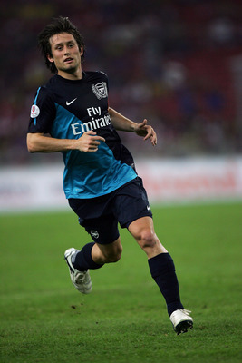 KUALA LUMPUR, MALAYSIA - JULY 13: Tomas Rosicky of Arsenal runs during the pre-season Asian Tour friendly match between Malaysia and Arsenal at Bukit Jalil National Stadium on July 13, 2011 in Kuala Lumpur, Malaysia.  (Photo by Stanley Chou/Getty Images)