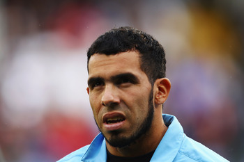 LONDON, ENGLAND - SEPTEMBER 18:  Carlos Tevez of Manchester City makes his way to the substitutes bench before the Barclays Premier League match between Fulham and Manchester City at Craven Cottage on September 18, 2011 in London, England.  (Photo by Juli