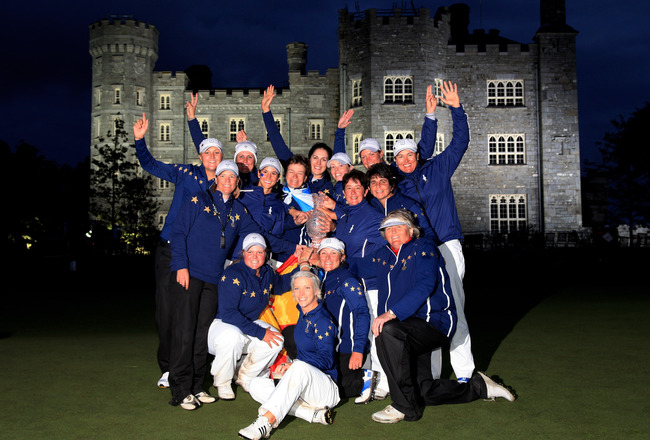DUNSHAUGHLIN, IRELAND - SEPTEMBER 25:  The European team celebrate with the trophy following their 15-13 victory during the singles matches on day three of the 2011 Solheim Cup at Killeen Castle Golf Club on September 25, 2011 in Dunshaughlin, County Meat
