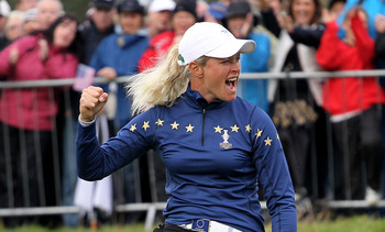DUNSHAUGHLIN, IRELAND - SEPTEMBER 25:  Suzann Pettersen of Europe celebrates on the 18th green during the singles matches on day three of the 2011 Solheim Cup at Killeen Castle Golf Club on September 25, 2011 in Dunshaughlin, County Meath, Ireland.  (Phot