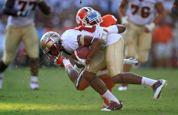 CLEMSON, SC - SEPTEMBER 24:  Rashad Greene #80 of the Florida State Seminoles is tackled by Bashaud Breeland #17 of the Clemson Tigers during their game at Memorial Stadium on September 24, 2011 in Clemson, South Carolina.  (Photo by Streeter Lecka/Getty
