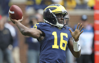 ANN ARBOR, MI - SEPTEMBER 24:  Denard Robinson #16 of the Michigan Wolverines drops back to pass during the game against the San Diego State Aztecs at Michigan Stadium on September 24, 2011 in Ann Arbor, Michigan. Michigan defeated San Diego State 28-7. (