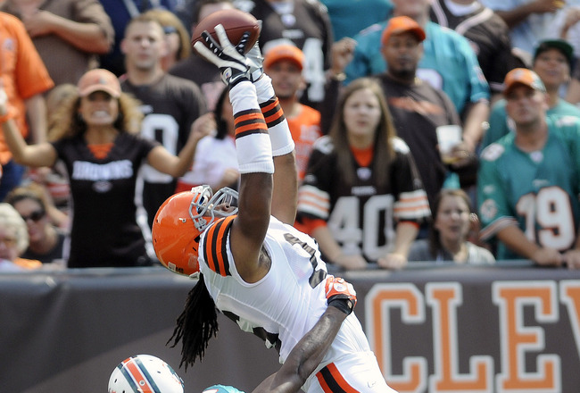 CLEVELAND, OH - SEPTEMBER 25: Wide Receiver Josh Cribbs #16 of the Cleveland Browns catches a touchdown pass over cornerback Sean Smith #24 of the Miami Dolphins during the second quarter at Cleveland Browns Stadium on September 25, 2011 in Cleveland, Ohi
