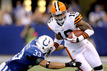 INDIANAPOLIS, IN - SEPTEMBER 18: Joshua Cribbs #17 of the Cleveland Browns carries the ball after making a reception against Melvin Bullitt #33 of Indianapolis Colts at Lucas Oil Stadium on September 18, 2011 in Indianapolis, Indiana.   (Photo by Matthew