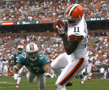 CLEVELAND, OH - SEPTEMBER 25:  Wide receiver Mohamed Massaquoi #11 of the Cleveland Browns catches a touchdown pass over cornerback Jimmy Wilson #27 of the Miami Dolphins at Cleveland Browns Stadium on September 25, 2011 in Cleveland, Ohio.  (Photo by Mat