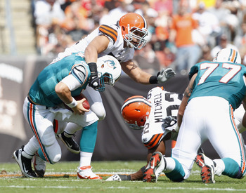 CLEVELAND, OH - SEPTEMBER 25:  Quarterback Chad Henne #7 of the Miami Dolphins is sacked by defenders Chris Gocong #51 and Jayme Mitchell #92 of the Cleveland Browns at Cleveland Browns Stadium on September 25, 2011 in Cleveland, Ohio.  (Photo by Matt Sul
