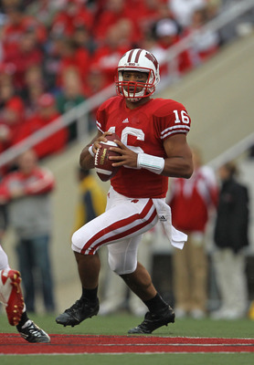 MADISON, WI - SEPTEMBER 24: Russell Wilson #16 of the Wisconsin Badgers looks for a receiver against the South Dakota Coyotes at Camp Randall Stadium on September 24, 2011 in Madison Wisconsin. Wisconsin defeated South Dakota 59-10.(Photo by Jonathan Dani