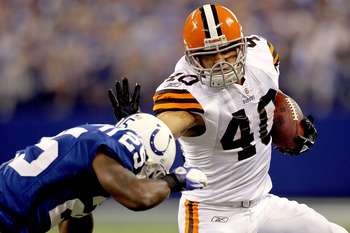 INDIANAPOLIS, IN - SEPTEMBER 18: Peyton Hillis #40 of the Cleveland Browns carries the ball against Jerraud Powers #25 of the Indianapolis Colts at Lucas Oil Stadium on September 18, 2011 in Indianapolis, Indiana.  (Photo by Matthew Stockman/Getty Images)