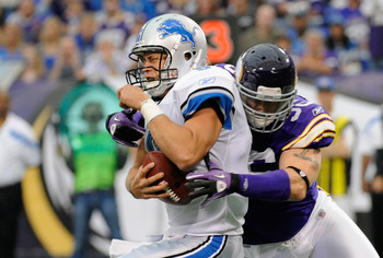 MINNEAPOLIS, MN - SEPTEMBER 25: Brian Robison #96 of the Minnesota Vikings sacks Matthew Stafford #9 of the Detroit Lions in the first quarter on September 25, 2011 at Hubert H. Humphrey Metrodome in Minneapolis, Minnesota. (Photo by Hannah Foslien/Getty