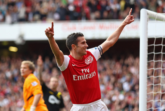 LONDON, ENGLAND - SEPTEMBER 24:  Robin Van Persie of Arsenal celebrates his second goal during the Barclays Premier League match between Arsenal and Bolton Wanderers at Emirates Stadium on September 24, 2011 in London, England.  (Photo by Clive Mason/Gett