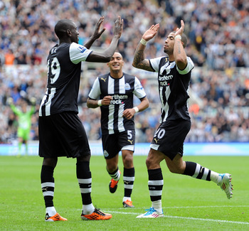 NEWCASTLE UPON TYNE, ENGLAND - AUGUST 28:  Leon Best (R) of Newcastle United celebrates scoring his side's second goal with team-mate Demba Ba during the Barclays Premier League match between Newcastle United and Fulham at St James' Park on August 28, 201