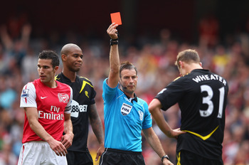 LONDON, ENGLAND - SEPTEMBER 24:  Referee Mark Clattenburg shows the red card to David Wheater of Bolton Wanderers during the Barclays Premier League match between Arsenal and Bolton Wanderers at Emirates Stadium on September 24, 2011 in London, England.
