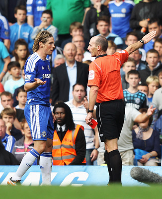 LONDON, ENGLAND - SEPTEMBER 24:  Fernando Torres of Chelsea is sent off by referee Mike Dean during the Barclays Premier League match between Chelsea and Swansea City at Stamford Bridge on September 24, 2011 in London, England.  (Photo by Clive Rose/Getty