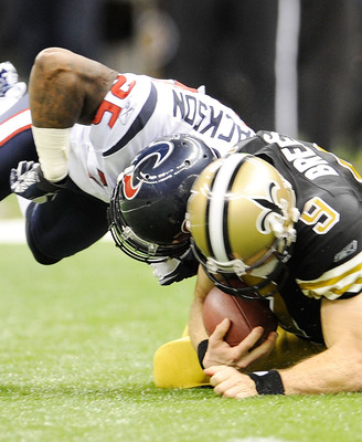 NEW ORLEANS, LA - SEPTEMBER 25:  Drew Brees #9 of the New Orleans Saints is hit while down by Kareem Jackson #25 of the Houston Texans during a game being held at the Louisiana Superdome on September 25, 2011 in New Orleans, Louisiana.  The Saints defeate