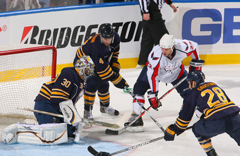 BUFFALO, NY - FEBRUARY 20: Ryan Miller #30, Steve Montador #4, and Paul Gaustad #28 of the Buffalo Sabres defend against Mike Knuble #22 of the Washington Capitals at HSBC Arena on February 20, 2011 in Buffalo, New York.  (Photo by Rick Stewart/Getty Imag