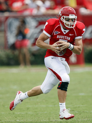 HOUSTON - SEPTEMBER 03:  Quarterback Case Keenum #7 of  the Houston Cougars looks for room to run on a bootleg against UCLA at Robertson Stadium on September 3, 2011 in Houston, Texas.  (Photo by Bob Levey/Getty Images)