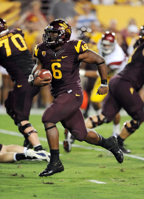 TEMPE, AZ - SEPTEMBER 24:  Cameron Marshall #6  of the Arizona State Sun Devils scores a touchdown against the University of Southern California Trojans at Sun Devil Stadium on September 24, 2011 in Tempe, Arizona.  (Photo by Norm Hall/Getty Images)