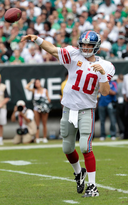 PHILADELPHIA, PA - SEPTEMBER 25:  Eli Manning #10 of the New York Giants throws against the Philadelphia Eagles at Lincoln Financial Field on September 25, 2011 in Philadelphia, Pennsylvania.  (Photo by Chris Trotman/Getty Images)