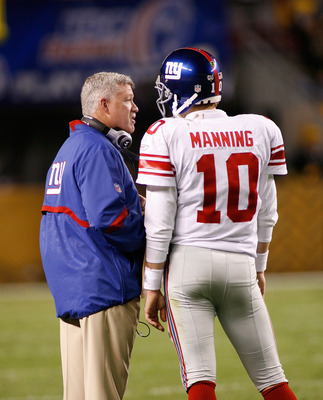 PITTSBURGH - OCTOBER 26:  Eli Manning #10 and Kevin Gilbride, offensive coordinator of the New York Giants talk during a timeout against the Pittsburgh Steelers on October 26, 2008 at Heinz Field in Pittsburgh, Pennsylvania.  (Photo by Rick Stewart/Getty