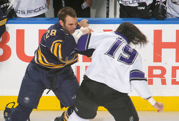 BUFFALO, NY - NOVEMBER 19: Paul Gaustad #28 of the Buffalo Sabres fights Kevin Westgarth #19 of the Los Angeles Kings at HSBC Arena on November 19, 2010 in Buffalo, New York.  (Photo by Rick Stewart/Getty Images)