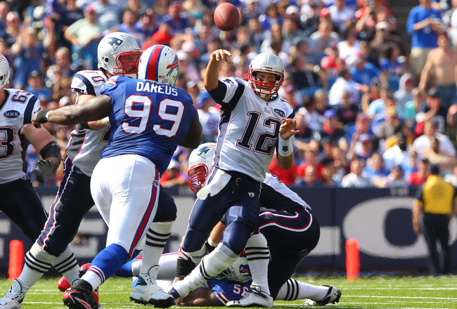 ORCHARD PARK, NY - SEPTEMBER 25: Tom Brady #12 of the New England Patriots cannot complete a pass under pressure in NFL game action against the Buffalo Bills at Ralph Wilson Stadium on September 25, 2011 in Orchard Park, New York. (Photo by Tom Szczerbows