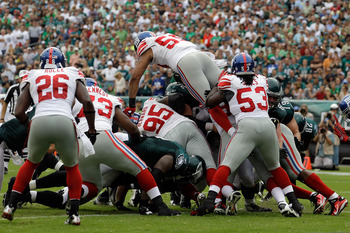 PHILADELPHIA, PA - SEPTEMBER 25:   Michael Boley #59 of the New York Giants and Greg Jones #53 along with the rest of the defense hold back a rush by the Philadelphia Eagles during the game at Lincoln Financial Field on September 25, 2011 in Philadelphia,