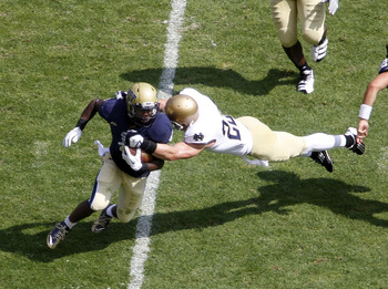 PITTSBURGH, PA - SEPTEMBER 24:  Ray Graham #1 of the Pittsburgh Panthers is tackled by Lo Wood #23 of the Notre Dame Fighting Irish during the game on September 24, 2011 at Heinz Field in Pittsburgh, Pennsylvania.  (Photo by Justin K. Aller/Getty Images)
