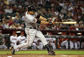 PHOENIX, AZ - SEPTEMBER 23:  Carlos Beltran #15 of the San Francisco Giants hits a single agianst the Arizona Diamondbacks during the first inning of the Major League Baseball game at Chase Field on September 23, 2011 in Phoenix, Arizona.  (Photo by Chris