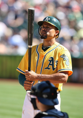 OAKLAND, CA - SEPTEMBER 18: Coco Crisp #4 of the Oakland Athletics stares at his bat before stepping into the batter's box during a game against the Detroit Tigers at O.co Coliseum on September 18, 2011 in Oakland, California.  (Photo by Tony Medina/Getty