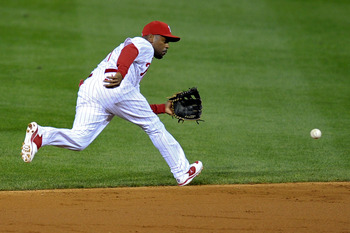 PHILADELPHIA, PA - SEPTEMBER 19: Jimmy Rollins #11 of the Philadelphia Phillies runs for a ground ball to put out Gerald Laird #13 of the St. Louis Cardinals at Citizens Bank Park on September 19, 2011 in Philadelphia, Pennsylvania. (Photo by Drew Hallowe
