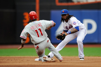 NEW YORK, NY - SEPTEMBER 25:  Jose Reyes #7 of the New York Mets tries to turn a double play as Jimmy Rollins #11 of the Philadelphia Phillies slides into second base in the fifth inning during a game at Citi Field on September 25, 2011 in the Flushing ne